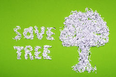 Save tree. Concept made from shredded paper on green background Stock Image