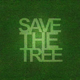 Save the tree on grass texture. Text save the tree on grass texture Royalty Free Stock Photography