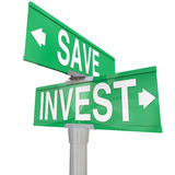 Save Vs Invest Words Two Way Street Signs Investment Choices Opt. Save Vs Invest words on two way road or street signs with arrows pointing the way to different royalty free illustration
