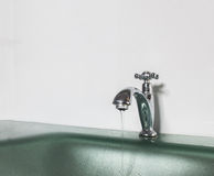 Save Water Save The World Concept, Water Drop from Old Silver Faucet in The Bathroom with Copyspace Royalty Free Stock Photo