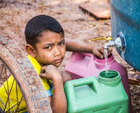 Save water in summer. Nakhon Ratchasima,THAILAND - March 4: Unidentified  Asian boy Saving water for use it in the family in summer no March 4,2016 in Khong Stock Images