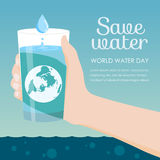 Save water in world water day - Hand holding a glass of water and earth vector design royalty free illustration