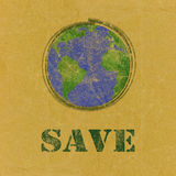 Save word with earth  on recycled paper Stock Photography