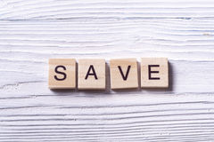 SAVE word written on wood block. Wooden abc royalty free stock image