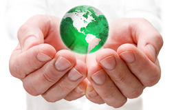 Save the world. Earth globe in human hands Stock Photo