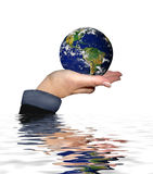 Save the world. Globe of the world held up and protected in the palm of a hand from water ripples below Stock Image
