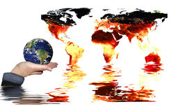 Save the world. Fiery hot and burning map of the world background sinking/drowning  in water with globe of the world held up and protected in the palm of a hand Stock Photo