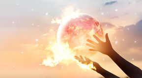 Save the world energy campaign. Planet earth with flamen. Save the world energy campaign. Planet earth with flame on human hands show energy consumption of Royalty Free Stock Images