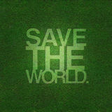 Save the world on grass texture Stock Image