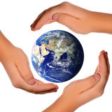 Save the world - hands around earth Stock Photos
