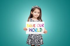 Save world save life save the planet, the ecosystem, green life. Concept. Little cute child girl with colorful sign save our world with green color background Stock Photos