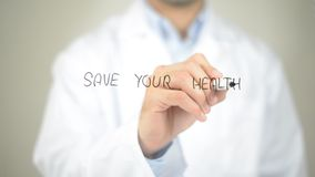 Save Your Health ,  Doctor writing on transparent screen Royalty Free Stock Photos