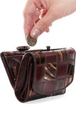 Save your money. A female hand put into purse a coin isolated over white background Royalty Free Stock Image