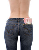 Save your tax money. Woman wearing jean with canadian money in her back pocket Stock Photos