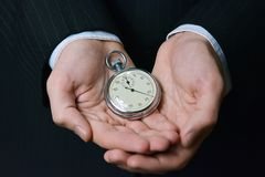 Save your time, stopwatch in hands Stock Photo