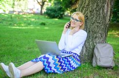 Save your time with shopping online. Sales manager occupation benefits. Woman with laptop in park order item on phone. Girl takes advantage of online shopping stock photos