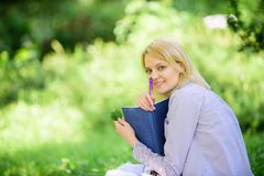 Save your time. Time management skill. Girl with business diary create her daily schedule. Woman relax nature background. Save time for relax. Create break for stock photo