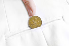 Saved penny is penny earned. Proverb representing coin in jacket pocket Stock Images