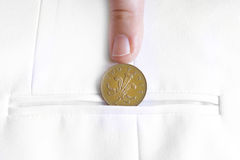 Saved penny is penny earned. Proverb representing coin in jacket pocket Royalty Free Stock Photography