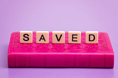 Saved Spelled Out. In Tiles royalty free stock image