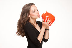 Saver. Portrait of a gorgeous young brunette woman posing with colorful piggy bank Royalty Free Stock Photography