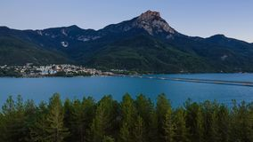 Savines-le-Lac, Grand Morgon Peak and the Serre-Poncon Lake from sunset to twilight. Hautes-Alpes, Alps, France. Timelapse of Savines-le-Lac, Grand Morgon Peak stock video
