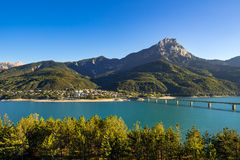 Savines-le-Lac village with the Grand Morgon and Serre-Poncon Lake in Summer. Alps, France Royalty Free Stock Photography