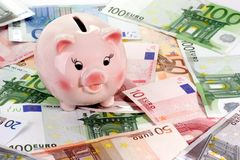 Saving. Pink piggy bank on euro notes Stock Images