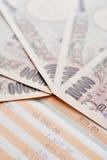 Saving account passbook and Japanese yen Stock Photos