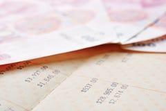 Saving account passbook and renminbi. Close up saving account passbook and renminbi Royalty Free Stock Photos