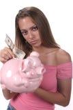 Saving big. Teen with big pink piggy bank Stock Photos