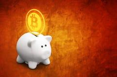 Saving bitcoins in piggy coin bank Royalty Free Stock Photos