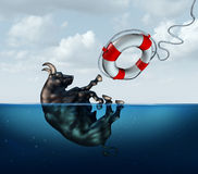 Saving The Bull Market. Business concept or financial investment safety metaphor as a bull drowning in water with a lifesaver coming to the assistance of the Royalty Free Stock Photography