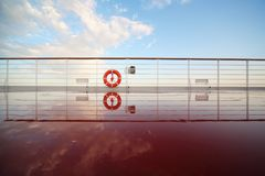 Saving buoy in deck of cruise ship. Royalty Free Stock Image