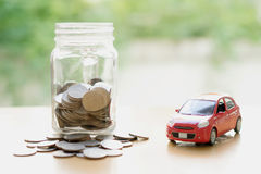 Saving for Car installment in the glass bottle Stock Image