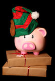Saving for christmas piggy bank elf Royalty Free Stock Images