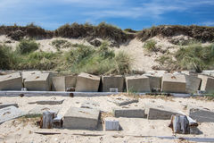 Saving the coastline. Coastal erosion management with concrete blocks. Sea defences in. Coastal erosion management with concrete blocks. Sea defences in front of Stock Image