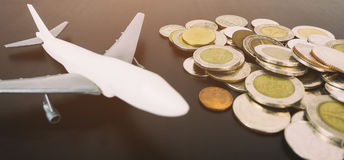 Saving coin money for world travel vacation Royalty Free Stock Photo