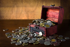 Saving coin in the wood box Stock Images