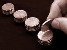 Saving coins Royalty Free Stock Photo