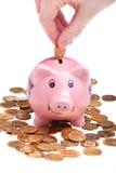 Saving coins for future Royalty Free Stock Photos