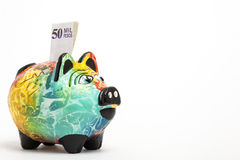 Saving colombian money in a Colorful piggy bank Royalty Free Stock Photo