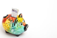 Saving colombian money in a Colorful piggy bank Stock Photography