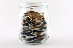 Saving concept with a money deposit. Using a jam glass Stock Photography