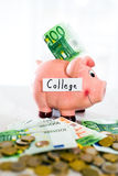 Saving concept. Piggy bank with an inscription college Royalty Free Stock Images
