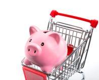 Saving concept, piggybank in cart Stock Images