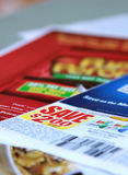 Saving coupons. Close up of saving discount manufacturer coupons Royalty Free Stock Photography