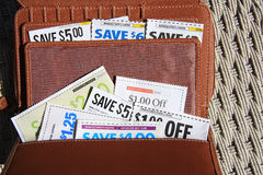Saving Coupons in wallet for shopping. Some coupons in brown  wallet for shooping Royalty Free Stock Image