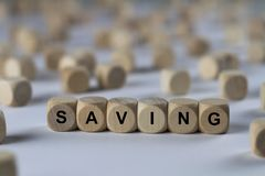 Saving - cube with letters, sign with wooden cubes stock images