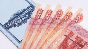 Saving deposit bank book and money Royalty Free Stock Image